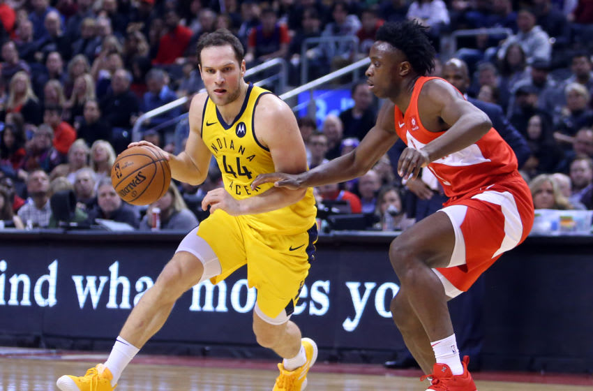 TORONTO, ON - JANUARY 6: Bojan Bogdanovic #44 of the Indiana Pacers dribbles the ball as OG Anunoby #3 of the Toronto Raptors defends during the first half of an NBA game at Scotiabank Arena on January 6, 2019 in Toronto, Canada. NOTE TO USER: User expressly acknowledges and agrees that, by downloading and or using this photograph, User is consenting to the terms and conditions of the Getty Images License Agreement. (Photo by Vaughn Ridley/Getty Images)
