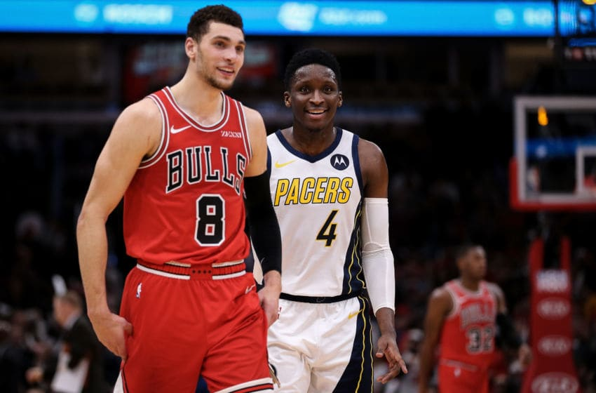 CHICAGO, ILLINOIS - JANUARY 04: Zach LaVine #8 of the Chicago Bulls and Victor Oladipo #4 of the Indiana Pacers walk across the floor in overtime at the United Center on January 04, 2019 in Chicago, Illinois. NOTE TO USER: User expressly acknowledges and agrees that, by downloading and or using this photograph, User is consenting to the terms and conditions of the Getty Images License Agreement. (Photo by Dylan Buell/Getty Images)