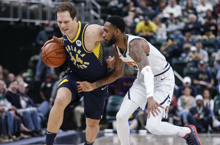 INDIANAPOLIS, IN - MARCH 24: Bojan Bogdanovic #44 of the Indiana Pacers dribbles the ball against Will Barton #5 of the Denver Nuggets at Bankers Life Fieldhouse on March 24, 2019 in Indianapolis, Indiana. (Photo by Michael Hickey/Getty Images)