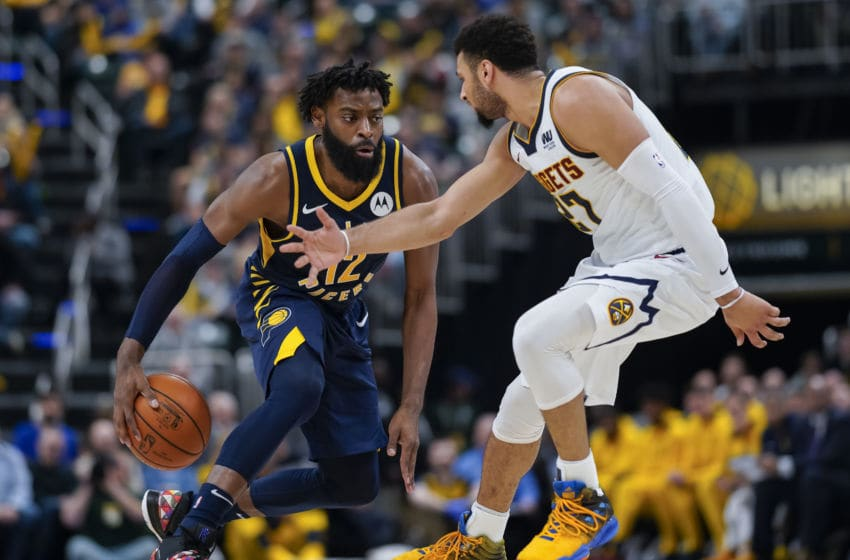 INDIANAPOLIS, IN - MARCH 24: Tyreke Evans #12 of the Indiana Pacers brings the ball up court during the game against Jamal Murray #27 of the Denver Nuggets at Bankers Life Fieldhouse on March 24, 2019 in Indianapolis, Indiana. (Photo by Michael Hickey/Getty Images)