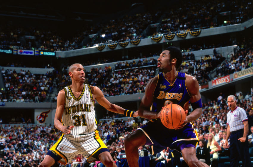 INDIANAPOLIS, IN - JUNE 16: Reggie Miller #31 of the Indiana Pacers defends Kobe Bryant #8 of the Los Angeles Lakers during Game Five of the NBA Finals on June 16, 2000 at the Conseco Fieldhouse in Indianapolis, Indiana. NOTE TO USER: User expressly acknowledges and agrees that, by downloading and/or using this photograph, user is consenting to the terms and conditions of the Getty Images License Agreement. Mandatory Copyright Notice: Copyright 2000 NBAE (Photo by Andy Hayt/NBAE via Getty Images)