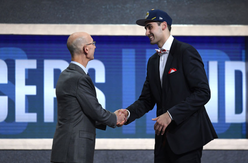 NEW YORK, NEW YORK - JUNE 20: Goga Bitadze poses with NBA Commissioner Adam Silver after being drafted with the 18th overall pick by the Indiana Pacers during the 2019 NBA Draft at the Barclays Center on June 20, 2019 in the Brooklyn borough of New York City. (Photo by Sarah Stier/Getty Images)