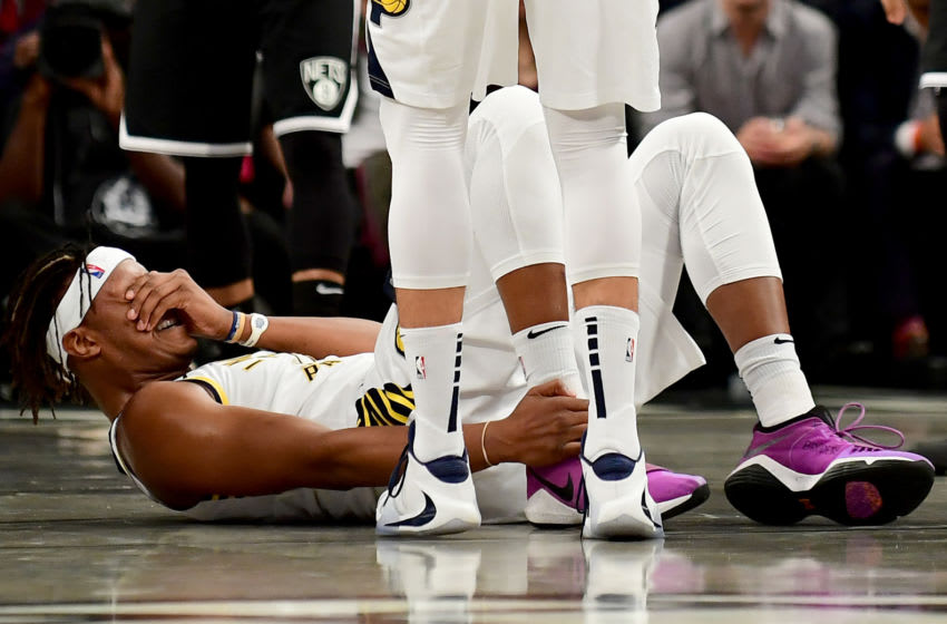 NEW YORK, NEW YORK - OCTOBER 30: Myles Turner #33 of the Indiana Pacers holds his ankle after getting hurt in the first half of their game against the Brooklyn Nets at Barclays Center on October 30, 2019 in the Brooklyn borough of New York City. NOTE TO USER: User expressly acknowledges and agrees that, by downloading and or using this Photograph, user is consenting to the terms and conditions of the Getty Images License Agreement. (Photo by Emilee Chinn/Getty Images)