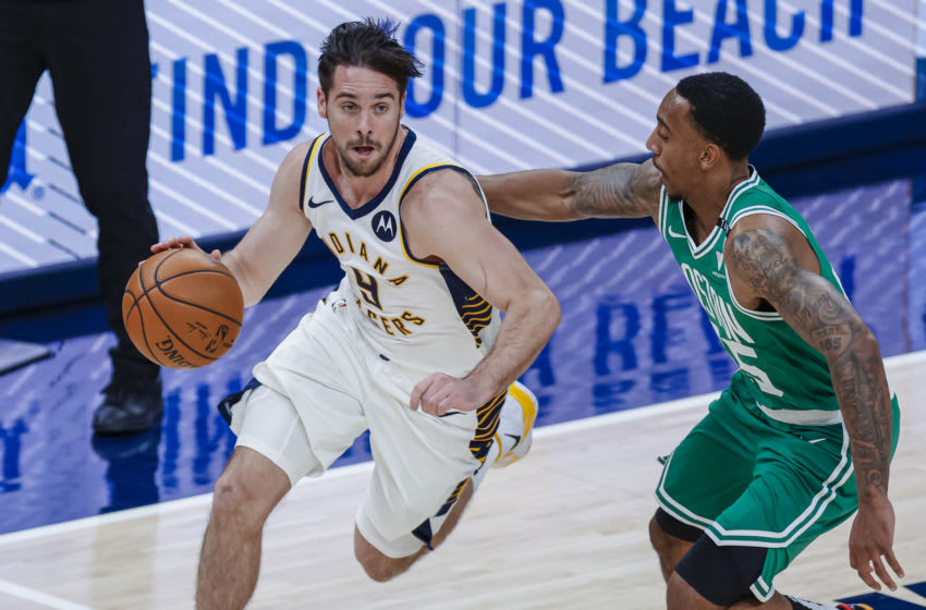 INDIANAPOLIS, IN - DECEMBER 29: T.J. McConnell #9 of the Indiana Pacers dribbles the ball against Jeff Teague #55 of the Boston Celtics at Bankers Life Fieldhouse on December 29, 2020 in Indianapolis, Indiana. NOTE TO USER: User expressly acknowledges and agrees that, by downloading and or using this photograph, User is consenting to the terms and conditions of the Getty Images License Agreement. (Photo by Michael Hickey/Getty Images)
