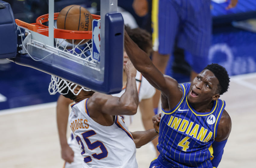 INDIANAPOLIS, IN - JANUARY 09: Victor Oladipo #4 of the Indiana Pacers goes up for the dunk against Mikal Bridges #25 of the Phoenix Suns during the second half at Bankers Life Fieldhouse on January 9, 2021 in Indianapolis, Indiana. NOTE TO USER: User expressly acknowledges and agrees that, by downloading and or using this photograph, User is consenting to the terms and conditions of the Getty Images License Agreement. (Photo by Michael Hickey/Getty Images)