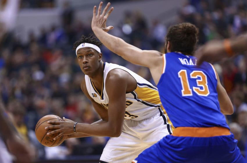 INDIANAPOLIS, IN - JANUARY 23: Myles Turner #33 of the Indiana Pacers holds the ball against Joakim Noah #13 of the New York Knicks at Bankers Life Fieldhouse on January 23, 2017 in Indianapolis, Indiana. NOTE TO USER: User expressly acknowledges and agrees that, by downloading and/or using this photograph, user is consenting to the terms and conditions of the Getty Images License Agreement. (Photo by Michael Hickey/Getty Images)