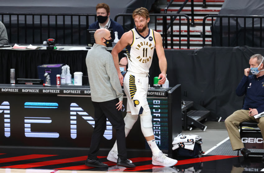 PORTLAND, OREGON - JANUARY 14: Head Coach Nate Bjorkgren and Domantas Sabonis #11 of the Indiana Pacers react in the second quarter against the Portland Trail Blazers at Moda Center on January 14, 2021 in Portland, Oregon. NOTE TO USER: User expressly acknowledges and agrees that, by downloading and or using this photograph, User is consenting to the terms and conditions of the Getty Images License Agreement. (Photo by Abbie Parr/Getty Images)