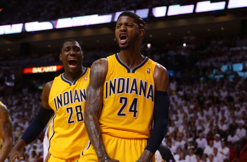 MIAMI, FL - MAY 24: Paul George #24 of the Indiana Pacers celebrates with Ian Mahinmi #28 after a dunk in the second half against the Miami Heat during Game Two of the Eastern Conference Finals at AmericanAirlines Arena on May 24, 2013 in Miami, Florida. NOTE TO USER: User expressly acknowledges and agrees that, by downloading and or using this photograph, user is consenting to the terms and conditions of the Getty Images License Agreement. (Photo by Mike Ehrmann/Getty Images)