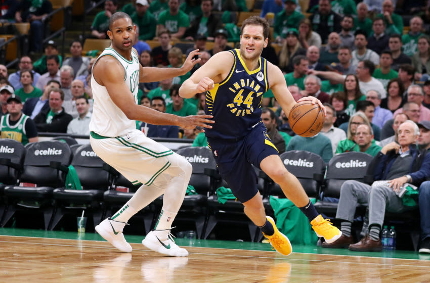 BOSTON, MASSACHUSETTS - APRIL 17: Bojan Bogdanovic #44 of the Indiana Pacers drives against Al Horford #42 of the Boston Celtics during the third quarter of Game Two of Round One of the 2019 NBA Playoffs at TD Garden on April 17, 2019 in Boston, Massachusetts. NOTE TO USER: User expressly acknowledges and agrees that, by downloading and or using this photograph, User is consenting to the terms and conditions of the Getty Images License Agreement. (Photo by Maddie Meyer/Getty Images)