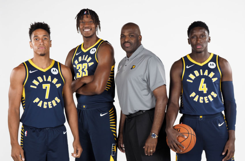 INDIANAPOLIS, IN - SEPTEMBER 27: Malcolm Brogdon #7, Myles Turner #33, Head Coach Nate McMillan and Victor Oladipo #4 of the Indiana Pacers pose for a portrait during media day on September 27, 2019 at Bankers Life Fieldhouse in Indianapolis, Indiana. NOTE TO USER: User expressly acknowledges and agrees that, by downloading and/or using this photograph, user is consenting to the terms and conditions of the Getty Images License Agreement. Mandatory Copyright Notice: Copyright 2019 NBAE (Photo by Ron Hoskins/NBAE via Getty Images)