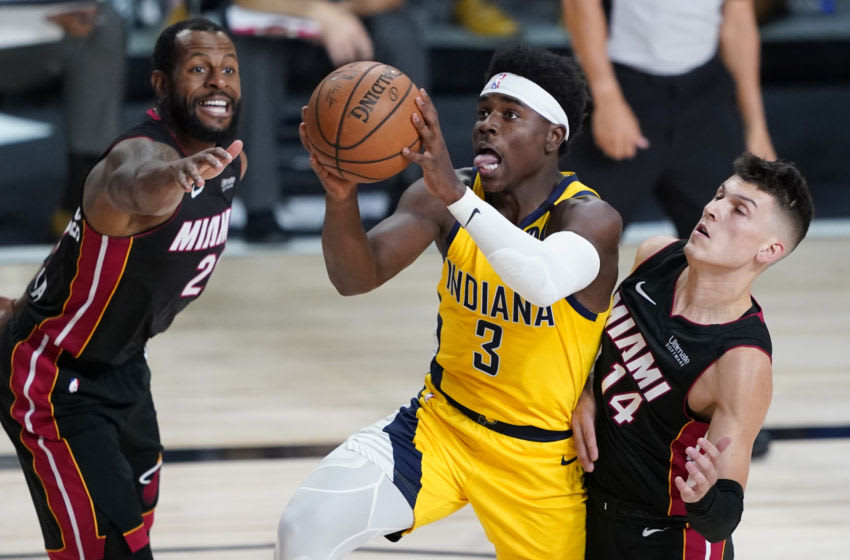 Aug 18, 2020; Lake Buena Vista, Florida, USA; Indiana Pacers guard Aaron Holiday (3) shoots past Miami Heat guard Tyler Herro (14) during the first half of an NBA basketball first round playoff game, Tuesday, Aug. 18, 2020, in Lake Buena Vista, Fla. at AdventHealth Arena. Mandatory Credit: Ashley Landis/Pool Photo-USA TODAY Sports