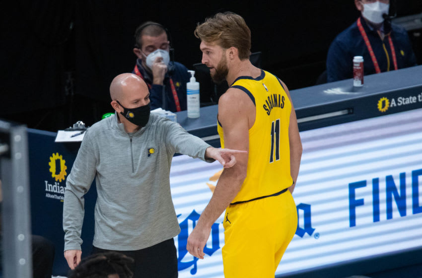 Jan 2, 2021; Indianapolis, Indiana, USA; Indiana Pacers head coach Nate Bjorkgren talks with Indiana Pacers forward Domantas Sabonis (11) on the sideline in the first quarter at Bankers Life Fieldhouse. Mandatory Credit: Trevor Ruszkowski-USA TODAY Sports