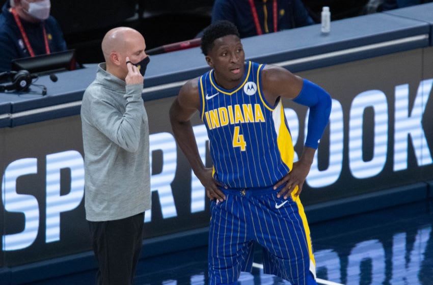 Jan 9, 2021; Indianapolis, Indiana, USA; Indiana Pacers head coach Nate Bjorkgren talks with guard Victor Oladipo (4) during a free throw in the fourth quarter against the Phoenix Suns at Bankers Life Fieldhouse. Mandatory Credit: Trevor Ruszkowski-USA TODAY Sports