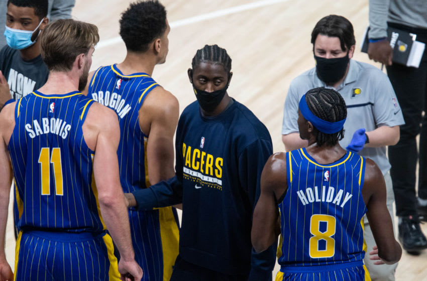 Jan 20, 2021; Indianapolis, Indiana, USA; Indiana Pacers guard Caris LeVert (22) during a timeout in the fourth quarter against the Dallas Mavericks at Bankers Life Fieldhouse. Mandatory Credit: Trevor Ruszkowski-USA TODAY Sports