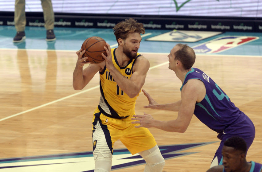 Jan 27, 2021; Charlotte, North Carolina, USA; Indiana Pacers forward Domantas Sabonis (11) looks to pass as he is defended by Charlotte Hornets forward center Cody Zeller (40) during the first half at the Spectrum Center. Mandatory Credit: Sam Sharpe-USA TODAY Sports