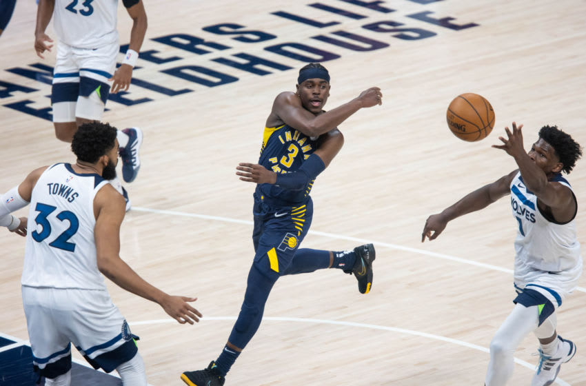 Apr 7, 2021; Indianapolis, Indiana, USA; Indiana Pacers guard Aaron Holiday (3) passes the ball in the second quarter against the Minnesota Timberwolves at Bankers Life Fieldhouse. Mandatory Credit: Trevor Ruszkowski-USA TODAY Sports