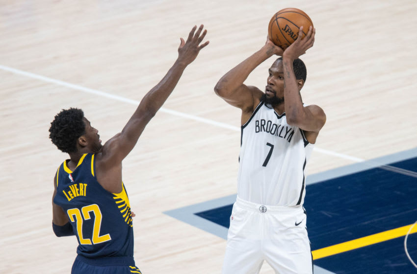 Apr 29, 2021; Indianapolis, Indiana, USA; Brooklyn Nets forward Kevin Durant (7) shoots the ball while Indiana Pacers guard Caris LeVert (22) defends in the third quarter at Bankers Life Fieldhouse. Mandatory Credit: Trevor Ruszkowski-USA TODAY Sports