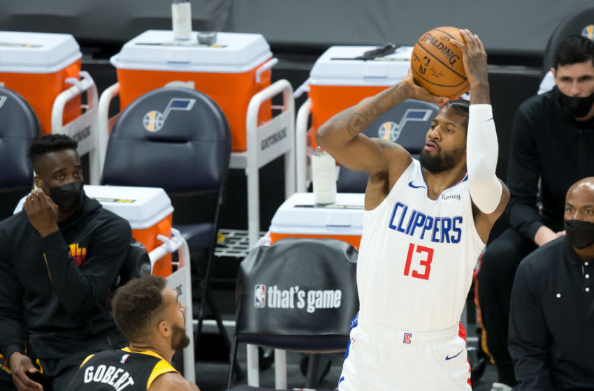 Jun 16, 2021; Salt Lake City, Utah, USA; LA Clippers guard Paul George (13) shoots the ball against Utah Jazz center Rudy Gobert (27) during the first quarter of game five in the second round of the 2021 NBA Playoffs at Vivint Arena. Mandatory Credit: Russell Isabella-USA TODAY Sports