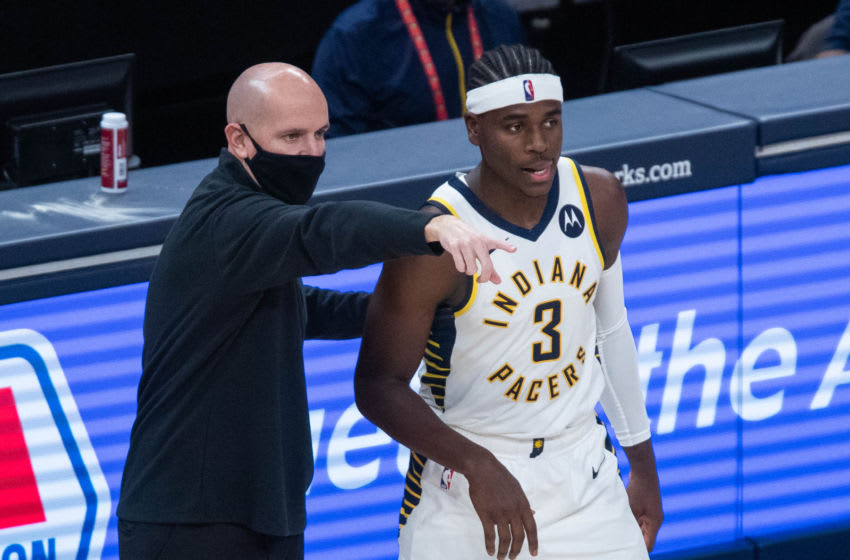 Jan 6, 2021; Indianapolis, Indiana, USA; Indiana Pacers head coach Nate Bjorkgren talks with guard Aaron Holiday (3) on the sideline in the third quarter against the Houston Rockets at Bankers Life Fieldhouse. Mandatory Credit: Trevor Ruszkowski-USA TODAY Sports