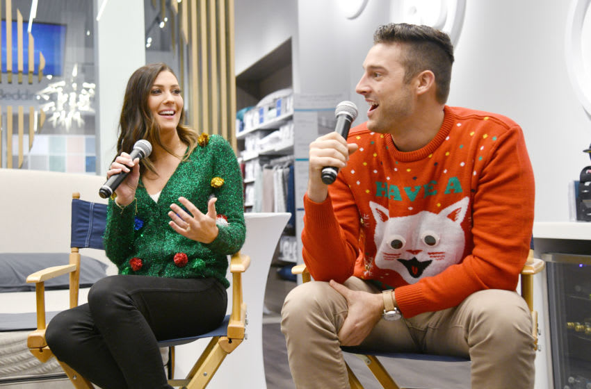 NEW YORK, NY - DECEMBER 14: Becca Kufrin and Garrett Yrigoyen speak as Sean and Catherine Lowe, Becca Kufrin and Garrett Yrigoyen celebrate Sleep Number with a Night 'Under the Mistletoe' at Sleep Number on December 14, 2018 in New York City. (Photo by Bryan Bedder/Getty Images for Sleep Number)