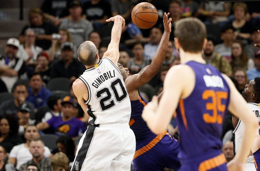 Dec 28, 2016; San Antonio, TX, USA; San Antonio Spurs shooting guard Manu Ginobili (20) blocks a shot attempt by Phoenix Suns small forward TJ Warren (12, behind) during the second half at AT&T Center. Mandatory Credit: Soobum Im-USA TODAY Sports