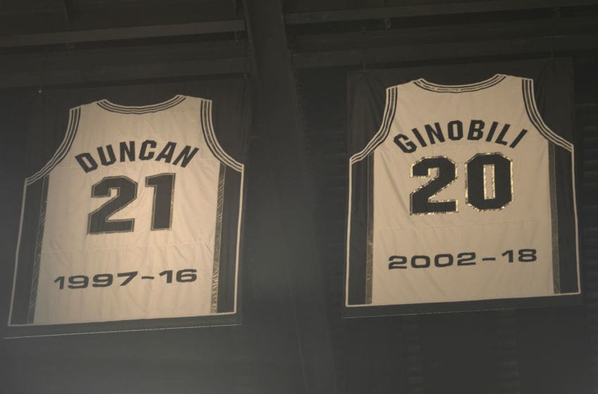 SAN ANTONIO, TX - MARCH 28: Jerseys of Retired NBA Legends Tim Duncan #21 and Manu Ginobili #20 of the San Antonio Spurs are seen in the rafters on March 28, 2018 at the AT&T Center in San Antonio, Texas. NOTE TO USER: User expressly acknowledges and agrees that, by downloading and or using this photograph, user is consenting to the terms and conditions of the Getty Images License Agreement. Mandatory Copyright Notice: Copyright 2018 NBAE (Photos by Mark Sobhani/NBAE via Getty Images)