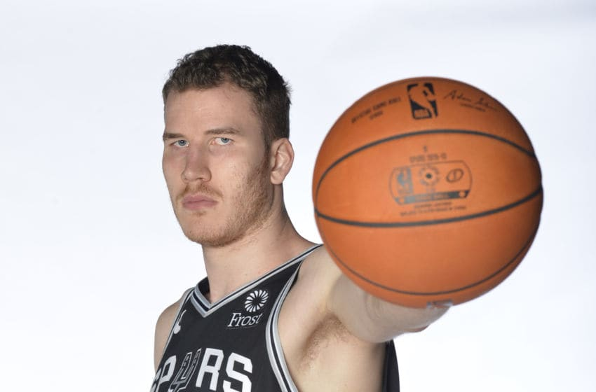 SAN ANTONIO, TX - SEPTEMBER 24: Jakob Poeltl #25 of the San Antonio Spurs poses for a portrait at media day on September 24, 2018 at the AT&T Center in San Antonio, Texas. NOTE TO USER: User expressly acknowledges and agrees that, by downloading and or using this photograph, User is consenting to the terms and conditions of the Getty Images License Agreement. Mandatory Copyright Notice: Copyright 2018 NBAE (Photo by Mark Sobhani/NBAE via Getty Images)