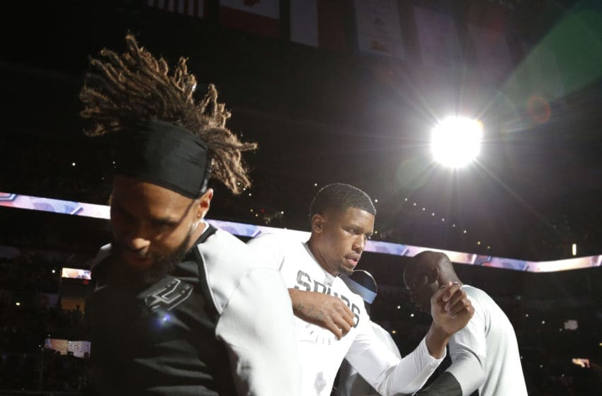 SAN ANTONIO,TX - SEPTEMBER 30 : Rudy Gay #22 of the San Antonio Spurs jumps with Patty Mills #8 during introductions in a preseason game against the Miami Heat at AT&T Center on September 30 , 2018 in San Antonio, Texas. NOTE TO USER: User expressly acknowledges and agrees that , by downloading and or using this photograph, User is consenting to the terms and conditions of the Getty Images License Agreement. (Photo by Ronald Cortes/Getty Images)