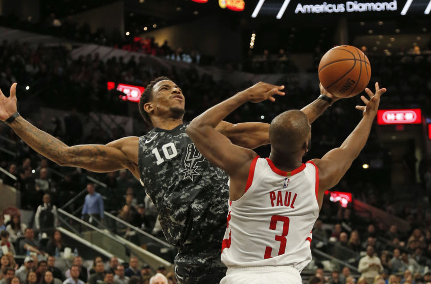 SAN ANTONIO,TX - NOVEMBER 10: DeMar DeRozan #10 of the San Antonio Spurs grabs a rebound over Chris Paul #3 of the Houston Rockets at AT&T Center on November 10 , 2018 in San Antonio, Texas. NOTE TO USER: User expressly acknowledges and agrees that , by downloading and or using this photograph, User is consenting to the terms and conditions of the Getty Images License Agreement. (Photo by Ronald Cortes/Getty Images)