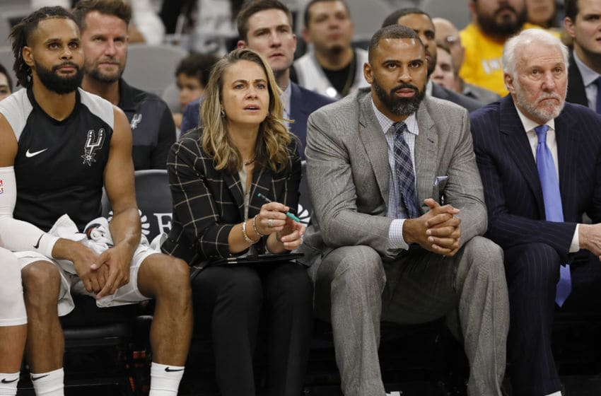 SAN ANTONIO, TX - OCTOBER 24: Patty Mills #8 of the San Antonio Spurs, assistant coaches Becky Hammon, Ime Udoka, and head coach Gregg Popovich watch action against the Indiana Pacers from the bench during an NBA game on October 24, 2018 at the AT&T Center in San Antonio, Texas. The Indiana Pacers won 116-96. NOTE TO USER: User expressly acknowledges and agrees that, by downloading and or using this photograph, User is consenting to the terms and conditions of the Getty Images License Agreement. (Photo by Edward A. Ornelas/Getty Images)