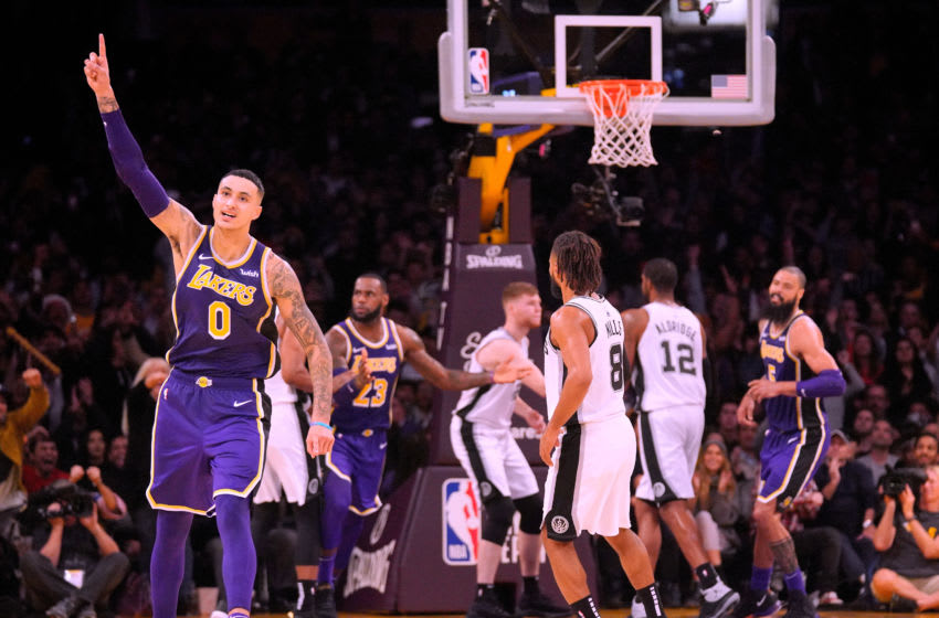 LOS ANGELES, CA - DECEMBER 05: Kyle Kuzma #0 of the Los Angeles Lakers celebrates his pass to LeBron James #23 resulting in a score during a 121-113 win over the San Antonio Spurs at Staples Center on December 5, 2018 in Los Angeles, California. NOTE TO USER: User expressly acknowledges and agrees that, by downloading and or using this photograph, User is consenting to the terms and conditions of the Getty Images License Agreement. (Photo by Harry How/Getty Images)