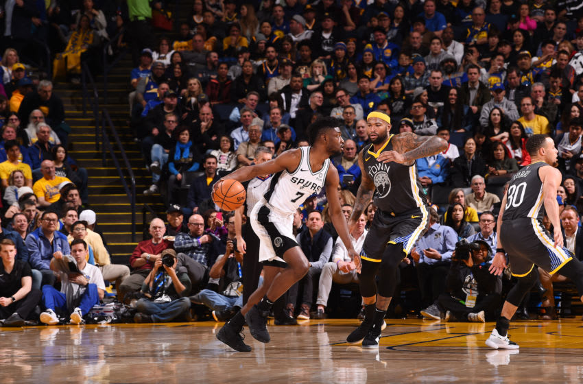OAKLAND, CA - FEBRUARY 6: Chimezie Metu #7 of the San Antonio Spurs handles the ball against the Golden State Warriors on February 6, 2019 (Photo by Noah Graham/NBAE via Getty Images)