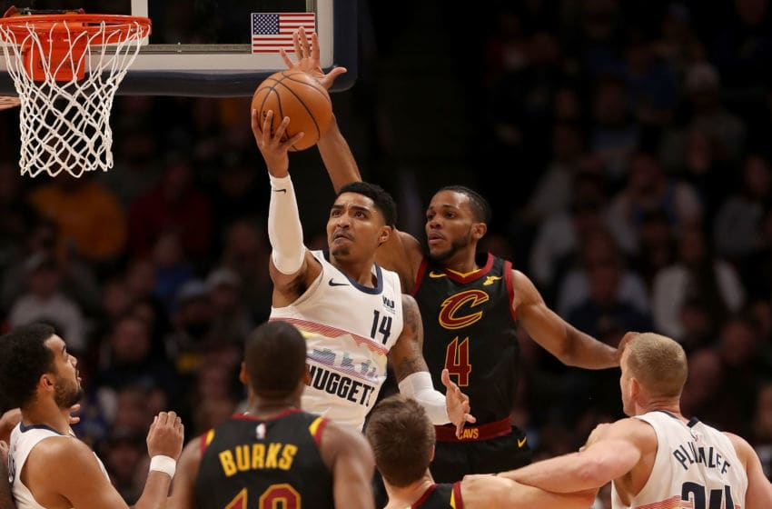 DENVER, COLORADO - JANUARY 19: Gary Harris #14 of the Denver Nuggets puts up a shot against Jaron Blossomgame #4 of the Cleveland Cavaliers at the Pepsi Center on January 19, 2019 in Denver, Colorado. NOTE TO USER: User expressly acknowledges and agrees that, by downloading and or using this photograph, User is consenting to the terms and conditions of the Getty Images License Agreement. (Photo by Matthew Stockman/Getty Images)