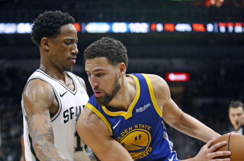 SAN ANTONIO, TX - MARCH 18: DeMar DeRozan #10 of the San Antonio Spurs pressures Klay Thompson #11 of the Golden State Warriors at AT&T Center on March 18, 2019 in San Antonio, Texas. NOTE TO USER: User expressly acknowledges and agrees that , by downloading and or using this photograph, User is consenting to the terms and conditions of the Getty Images License Agreement. (Photo by Ronald Cortes/Getty Images)