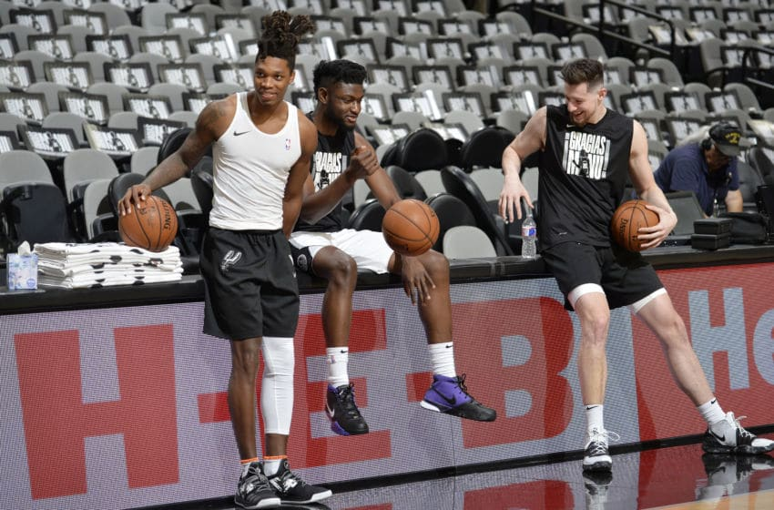 SAN ANTONIO, TX - MARCH 28: Lonnie Walker IV, Chimezie Metu #7, and Drew Eubanks #14 of the San Antonio Spurs warm up before the game against the Cleveland Cavaliers on March 28, 2018 (Photos by Mark Sobhani/NBAE via Getty Images)