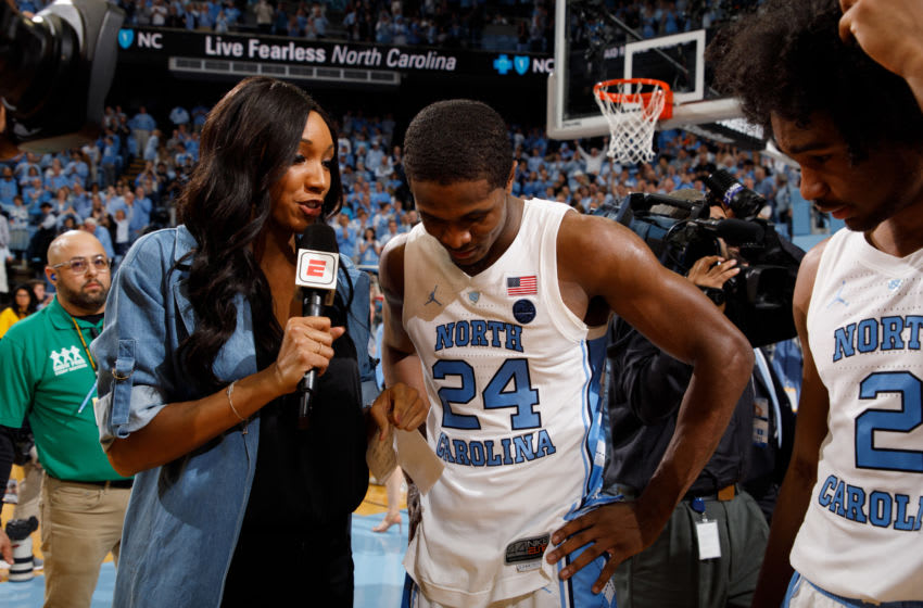 CHAPEL HILL, NC - MARCH 09: Kenny Williams #24 and Coby White #2 of the North Carolina Tar Heels speak to Maria Taylor of ESPN after a game against the Duke Blue Devils on March 09, 2019 at the Dean Smith Center in Chapel Hill, North Carolina. North Carolina won 70-79. (Photo by Peyton Williams/UNC/Getty Images)
