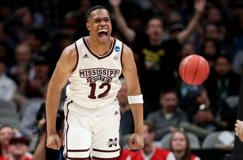 SAN JOSE, CALIFORNIA - MARCH 22: Robert Woodard #12 of the Mississippi State Bulldogs reacts to a play against the Liberty Flames during their game in the First Round of the NCAA Basketball Tournament at SAP Center on March 22, 2019 in San Jose, California. (Photo by Ezra Shaw/Getty Images)