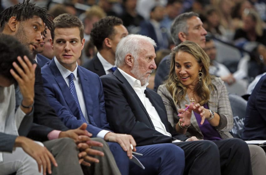 SAN ANTONIO, TX - OCTOBER 13: Spurs coaches Tim Duncan, Will Hardy, Gregg Popovich, and Becky Hammon talk during a preseason game against the New Orleans Pelicans at AT&T Center. (Photo by Ronald Cortes/Getty Images)