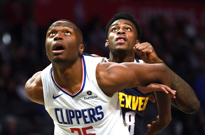LOS ANGELES, CALIFORNIA - OCTOBER 10: The San Antonio Spurs should target Mfiondu Kabengele #25 of the LA Clippers, who's seen boxing out Jarred Vanderbilt #8 of the Denver Nuggets. (Photo by Harry How/Getty Images)