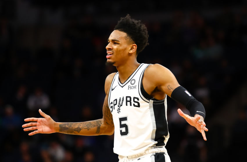 MINNEAPOLIS, MN - NOVEMBER 13: Dejounte Murray #5 of the San Antonio Spurs reacts after getting called for a foul against the Minnesota Timberwolves in the second quarter of the game at Target Center on November 13, 2019 in Minneapolis, Minnesota. The Timberwolves defeated the spurs 129-114. NOTE TO USER: User expressly acknowledges and agrees that, by downloading and or using this Photograph, user is consenting to the terms and conditions of the Getty Images License Agreement. (Photo by David Berding/Getty Images)