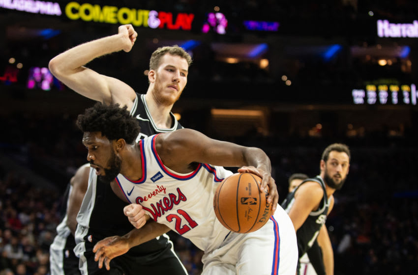 PHILADELPHIA, PA - NOVEMBER 22: Joel Embiid #21 of the Philadelphia 76ers dribbles past Jakob Poeltl #25 of the San Antonio Spurs during the third quarter of a game at the Wells Fargo Center on November 22, 2019 in Philadelphia, Pennsylvania. NOTE TO USER: User expressly acknowledges and agrees that, by downloading and or using this photograph, User is consenting to the terms and conditions of the Getty Images License Agreement. (Photo by Cameron Pollack/Getty Images)