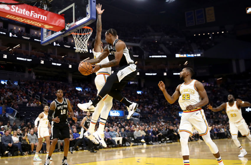 SAN FRANCISCO, CALIFORNIA - NOVEMBER 01: DeMar DeRozan #10 passes to LaMarcus Aldridge #12 of the San Antonio Spurs during their game against the Golden State Warriors (Photo by Ezra Shaw/Getty Images)