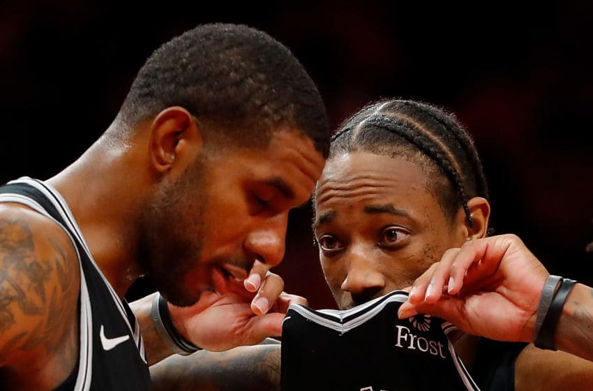 ATLANTA, GEORGIA - NOVEMBER 05: DeMar DeRozan #10 of the San Antonio Spurs converses with LaMarcus Aldridge #12 prior to taking free throws in the second half against the Atlanta Hawks at State Farm Arena on November 05, 2019 in Atlanta, Georgia. NOTE TO USER: User expressly acknowledges and agrees that, by downloading and/or using this photograph, user is consenting to the terms and conditions of the Getty Images License Agreement. (Photo by Kevin C. Cox/Getty Images)