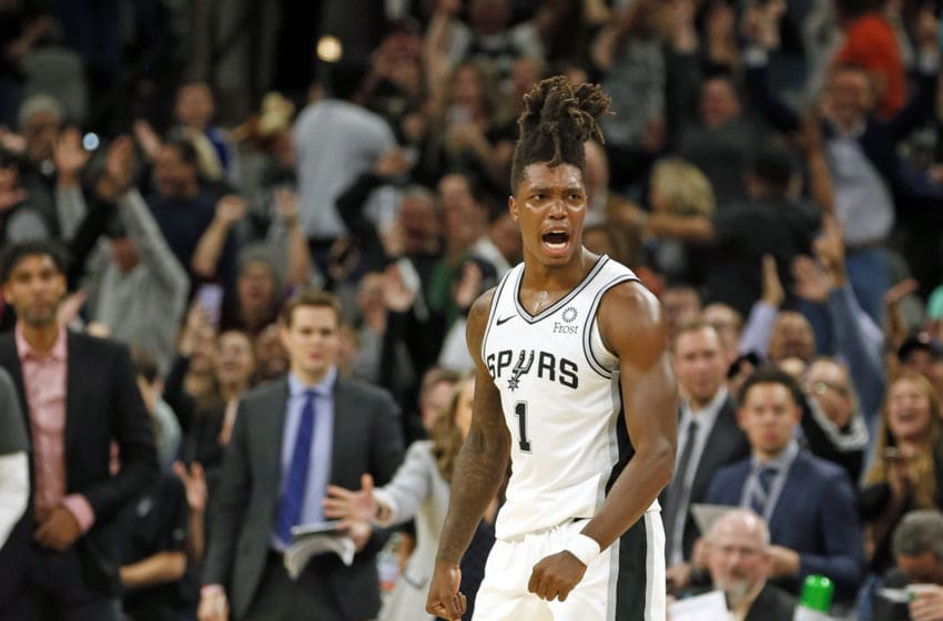 SAN ANTONIO, TX - DECEMBER 3: Lonnie Walker #1 of the San Antonio Spurs reacts after hitting a three against the Houston Rockets in the second half at AT&T Center on December 3, 2019 in San Antonio, Texas (Photo by Ronald Cortes/Getty Images)