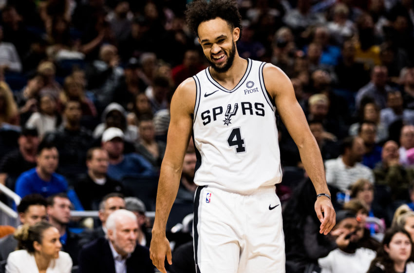 ORLANDO, FLORIDA - NOVEMBER 15: Derrick White #4 of the San Antonio Spurs enters the game against the Orlando Magic in the first quarter at Amway Center on November 15, 2019 in Orlando, Florida. NOTE TO USER: User expressly acknowledges and agrees that, by downloading and/or using this photograph, user is consenting to the terms and conditions of the Getty Images License Agreement. (Photo by Harry Aaron/Getty Images)