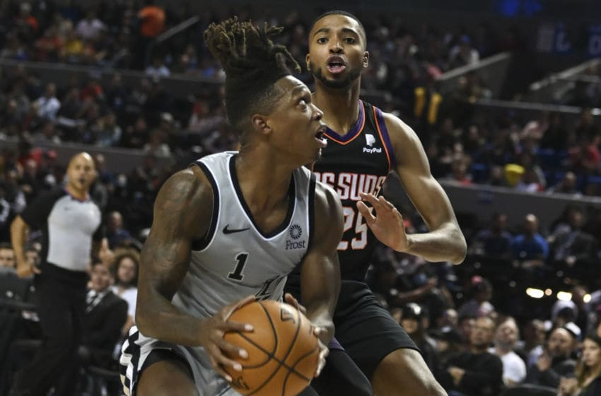 San Antonio Spurs' US shooting guard Lonnie Walker (L) vies for the ball with Phoenix Suns' US small forward Mikal Bridges during an NBA Global Games basketball match in Mexico City, on December 14, 2019. (Photo by PEDRO PARDO / AFP) (Photo by PEDRO PARDO/AFP via Getty Images)