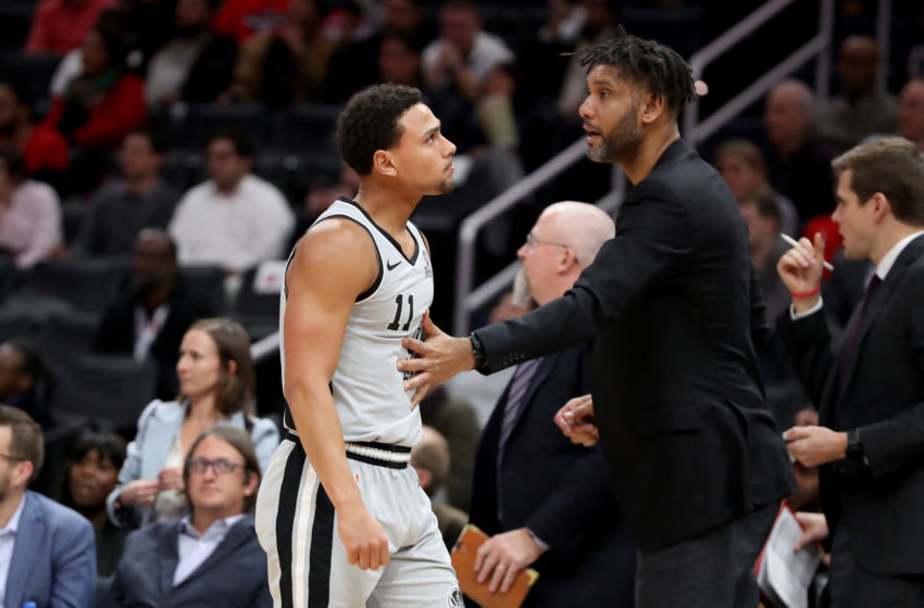 WASHINGTON, DC - NOVEMBER 20: Bryn Forbes #11 of the San Antonio Spurs reacts with assistant coach Tim Duncan after missing two free throws late in the fourth quarter against the Washington Wizards at Capital One Arena on November 20, 2019 in Washington, DC. NOTE TO USER: User expressly acknowledges and agrees that, by downloading and/or using this photograph, user is consenting to the terms and conditions of the Getty Images License Agreement. (Photo by Rob Carr/Getty Images)