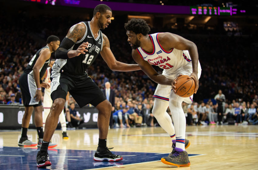 PHILADELPHIA, PA - NOVEMBER 22: Joel Embiid #21 of the Philadelphia 76ers dribbles against LaMarcus Aldridge #12 of the San Antonio Spurs during the third quarter of a game at the Wells Fargo Center on November 22, 2019 in Philadelphia, Pennsylvania. NOTE TO USER: User expressly acknowledges and agrees that, by downloading and or using this photograph, User is consenting to the terms and conditions of the Getty Images License Agreement. (Photo by Cameron Pollack/Getty Images)