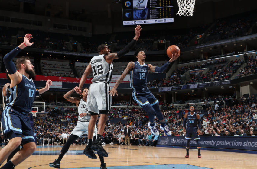 MEMPHIS, TN - DECEMBER 23: Ja Morant #12 of the Memphis Grizzlies shoots the ball against the San Antonio Spurs on December 23, 2019 at FedExForum in Memphis, Tennessee. NOTE TO USER: User expressly acknowledges and agrees that, by downloading and or using this photograph, User is consenting to the terms and conditions of the Getty Images License Agreement. Mandatory Copyright Notice: Copyright 2019 NBAE (Photo by Joe Murphy/NBAE via Getty Images)
