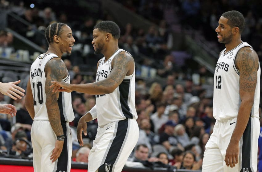 SAN ANTONIO, TX - DECEMBER 28: DeMar DeRozan #10 of the San Antonio Spurs celebrates with Rudy Gay #22 and LaMarcus Aldridge #12 during a time-out in game against the Detroit Pistons during second half action at AT&T Center on December 28, 2019 in San Antonio, Texas. San Antonio Spurs defeated the Detroit Pistons 136-109. NOTE TO USER: User expressly acknowledges and agrees that , by downloading and or using this photograph, User is consenting to the terms and conditions of the Getty Images License Agreement. (Photo by Ronald Cortes/Getty Images)